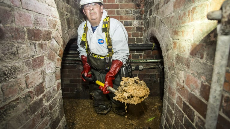 A Thames Water worker removes part of the fatberg beneath Whitechapel in London.