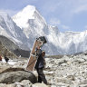 A porter carries crates containing oxygen tanks on his way towards Everest Base Camp.