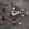 Relatives perform the last rites for the cremation of a man who died after contracting Covid-19 on the banks of the Ganges river in Allahabad, Uttar Pradesh, India.