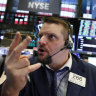 Wall Street slid again as trade jitters rose.