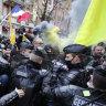 Demonstrators torch cars, smash windows in Paris protest