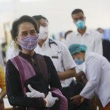Aung San Suu Kyi last week inspecting the vaccination processes of health workers at a hospital in Naypyitaw, Myanmar.