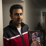 Baljit Khare with a photo of his wife.
