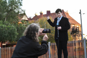 Got the shot? Leonardo Puglisi, 12, filmed by father Bendedict indicates the turret that held the bell tower, at West Hawthorn Primary school.