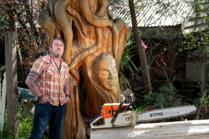 Like a gallery: Artist Leigh Conkie with one of his sculptures in front of his Eltham house.