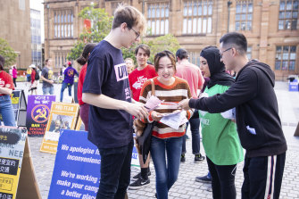 Campaigners contest a voter at student elections at the University of Sydney on September 26. A day earlier, pollsters (not pictured) had asked voters to complete a survey that asked controversial questions about Chinese people.