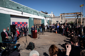 Rudy Giuliani speakomg to the media at a press conference held in the car park of a landscaping company in Pennsylvania on November 7.