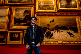 French artist JR, photographed in the 18th and 19th century salon gallery at NGV International on Friday night.