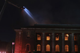 Firefighters work to douse the flames engulfing Jagger Library at the University of Cape Town.
