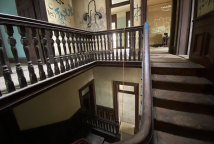 The main central staircase inside Home at Kangaroo Point appears in reasonably good condition, despite 119 years of use.