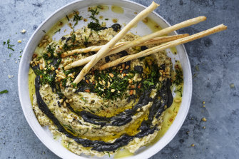 Baba ganoush with black tahini and toasted pine nuts.