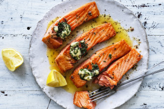 Grilled ocean trout with garlic, rosemary and anchovy butter.