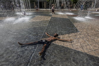 Kais Bothe relaxes in the cool in the city hall pool, as temperatures hit 37 degrees in Edmonton, Alberta, on Wednesday.
