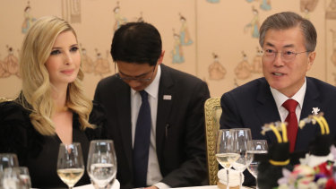 Ivanka Trump and South Korean President Moon Jae-in (right) attend a dinner in South Korea at the same time the US announced tough new sanctions.