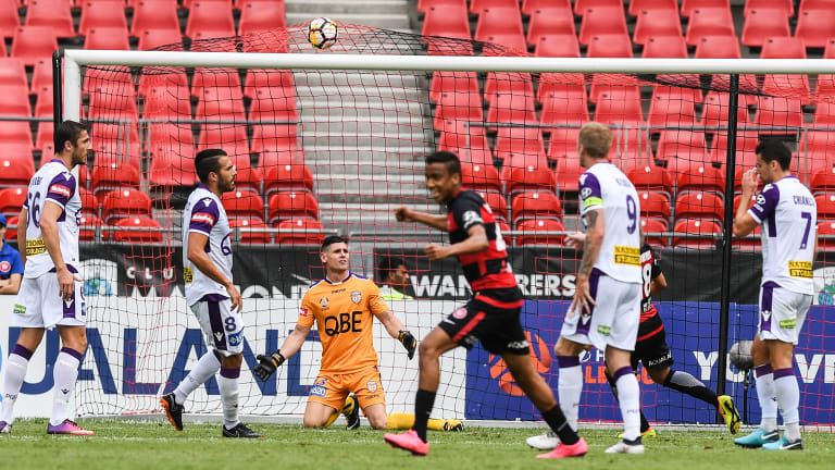 Beaten: Liam Reddy looks on as Mark Bridge's shot opens the scoring for the Wanderers.