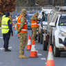 Australian Army soldiers assist New South Wales Police Officers at the Wodonga Place border control point in Albury.