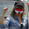 Seatbelts off, masks on: Lebanon's protesters shake fists from their cars
