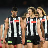The Magpies leave the field after losing to the Giants.