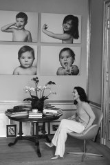 Mary, Crown Princess of Denmark. in front of portraits of her four children - Christian, Josephine, Vincent and Isabella.