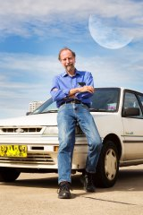 "Astronomer Dick Hunstead with the Nissan that had ""been to the moon and back""."