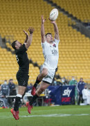 South's Will Jordan, right, leaps to take the ball to score the match winning try during the North vs South rugby game in Wellington, New Zealand, Saturday, Sept. 5, 2020. The All Blacks which will be named Sunday, Sept 6.