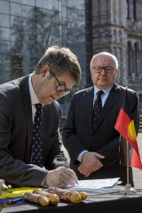 Natural History Museum Director Sir Michael Dixon (left) and Australian High Commissioner to the United Kingdom George Brandis during Tuesday's  repatriation ceremony in London.