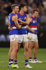 Bailey Dale, Josh Dunkley, and Jack Macrae after their grand final loss to Melbourne.