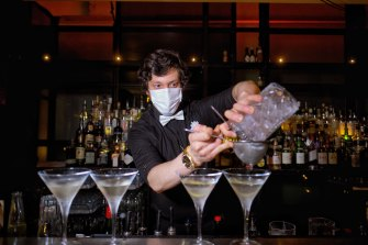 A barman at The Supper Club in the early hours.
