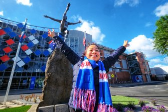 Western Bulldogs supporter Eloiza Soluta celebrates her team making the AFL grand final at Whitten Oval on Sunday.