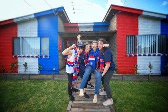 Bulldogs fans Venu, Taegan, Belinda and Charlize outside their home in Altona.