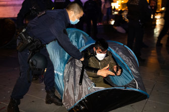 Police removed tents from the Place de la Republique in Paris with migrants still in them.