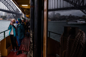 Passengers take in the final moments of the Queenscliff's last journey on Wednesday.