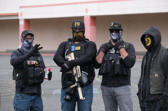 Members of the Proud Boys obscure their identity at a rally on the outskirts of Portland, Oregon, on August 22.