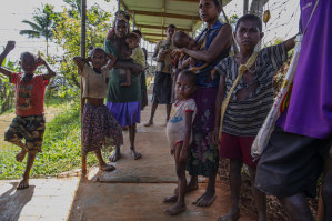 September, 2018: Families wait at a health clinic in PNG. It's the best facility within six days' walk for many.