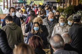 Melburnians wearing masks around South Melbourne Market in June.