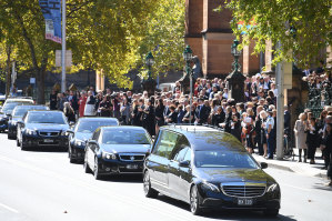 The cortege slowly leaves St Mary's Cathedral on Thursday down College Street.