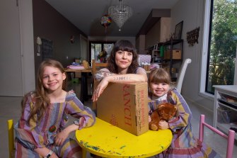 Dawn Rieniets with daughters Lavinia, 8, and Imogen, 4, who are no longer able to get parcels sent from the US.