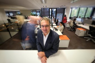 Victorian Chamber of Commerce and Industry chief executive Paul Guerra at his busy office on Thursday.