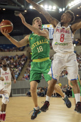 Leap of faith: Australia's Jesse Wagstaff takes the ball to the bucket against Calvin Abueva of the Philippines.
