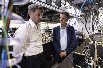 Professor Michael Biercuk and NSW Transport Minister inspect a quantum computer at the University of Sydney.