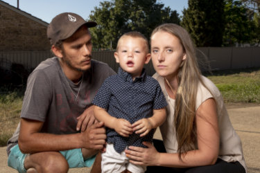 Chris Reynolds (left) and Cassandra Brown-Crane (right) with their two-year-old son Alijah Reynolds the day after he was allegedly left in a bus at a childcare centre.