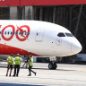 Qantas slashes flights as coronavirus costs near $150m