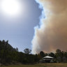 Queensland fire threat to lower on Saturday but fires still burning