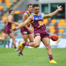 Lions cling on for narrow win over Dockers