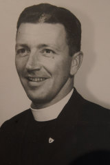 Peter Robinson in his early days as a priest.