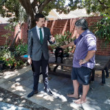 Zak Kirkup in Mount Lawley with a voter and a pug.