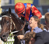 Glen Boss celebrates with strapper Nathan Kynes after the George Ryder Stakes