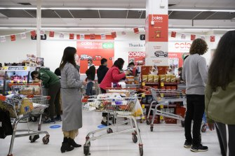 Shoppers lining up at Broadway Coles last month.
