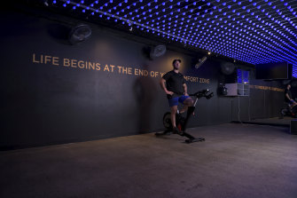 Flow Athletic's Ben Lucas pictured in an empty spin studio after lending his bikes to members to use at home.