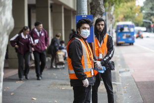 NSW Transport workers ready to clean buses outside Parramatta Station on Monday.